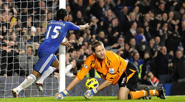 Chelsea's Florent Malouda celebrates after scoring his side's first goal past Bolton goal keeper Jussi Jaaskelainen during the Barclays Premier League match at Stamford Bridge, London.