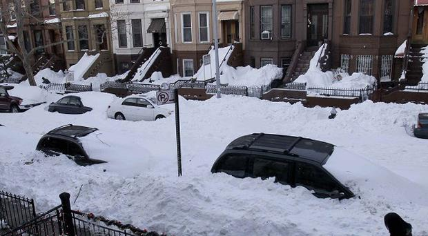 Many snow-bound streets remain unploughed in the Sunset Park section of Brooklyn, New York City (AP)