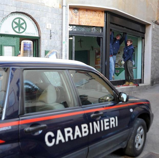 A police car at the right-wing Northern League party's HQ in Gemonio, near Varese, Italy (AP)