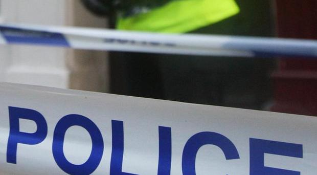 Four men have been arrested on suspicion of murder after a young man was fatally wounded at his home in Slough, Berkshire