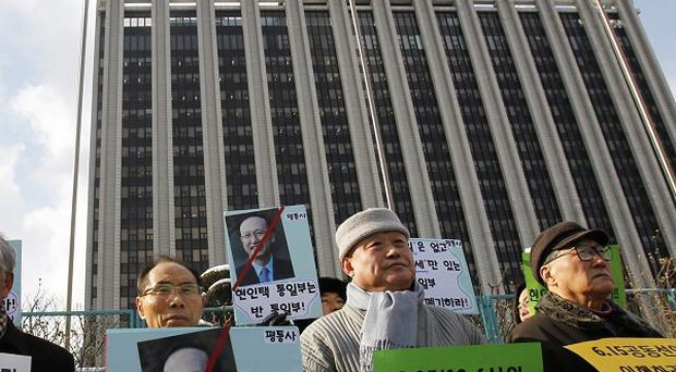South Korean protesters denounce the government's policy over North Korea in Seoul (AP)