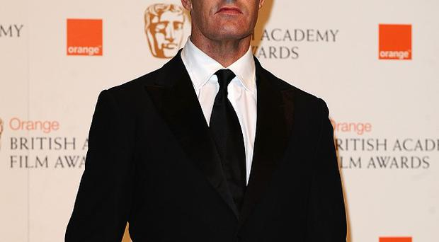 Rupert Everett reckons his Hollywood career suffered after he revealed he was gay