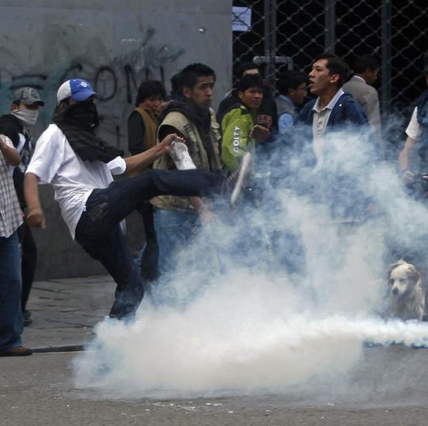 Demonstrators protest against fuel price rises in La Paz, Bolivia (AP)