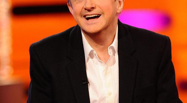 Louis Walsh reckons he's like a backing singer in Simon Cowell's 'band'