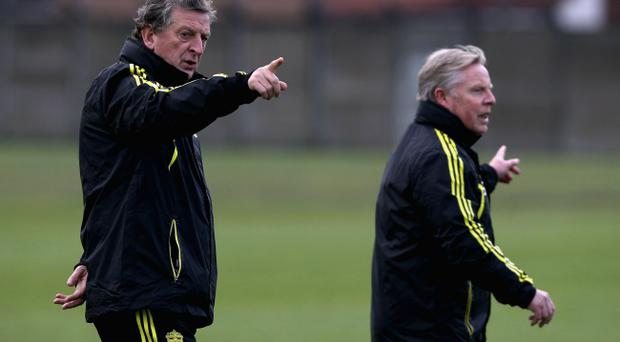 Under-fire Liverpool boss Roy Hodgson and assistant Sammy Lee try to give the right instructions in training but Hodgson's days at Anfield now look numbered