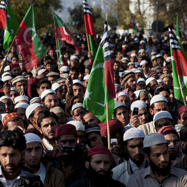 Supporters of Pakistani religious parties attend a rally to protest against any attempts to modify blasphemy laws (AP)