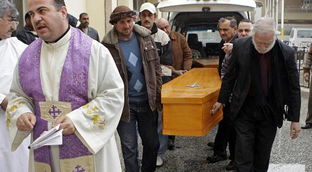 At least two Christians have been killed by militants in Iraq (AP)
