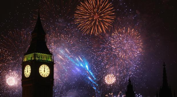 LONDON, ENGLAND - JANUARY 01: Fireworks light up the London skyline and Big Ben just after midnight on January 1, 2011 in London, England. Thousands of people lined the banks of the River Thames in central London to see in the New Year with a spectacular fireworks display. (Photo by Dan Kitwood/Getty Images)