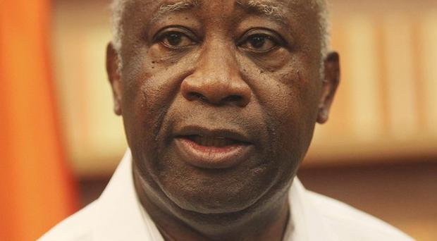 Ivory Coast president Laurent Gbagbo refuses to cede power (AP)