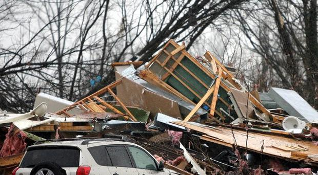 Debris from a house in Missouri after tornadoes killed six people in the US