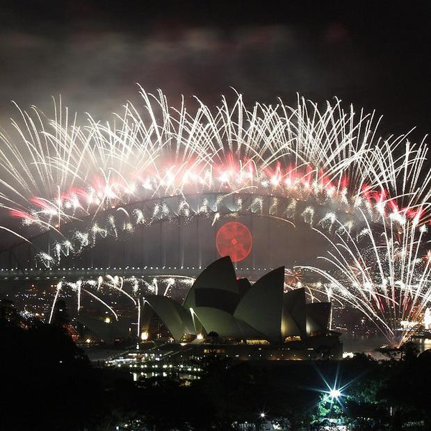 The sky above Sydney Harbour lights up at midnight during the fireworks display to celebrate the New Year's Day (AP)