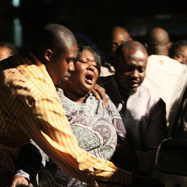 A woman who lost a relative in a bomb explosion mourns at the Asokoro General Hospital, Abuja, Nigeria (AP)
