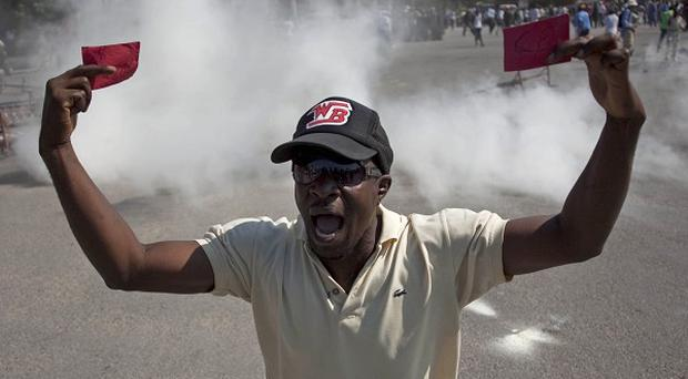 Demonstrators blocked roads and filled streets with rubbish in Haiti's capital, Port-au-Prince (AP)