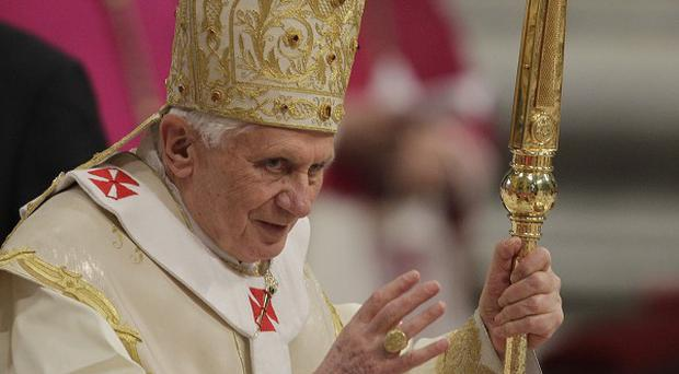 Pope Benedict XVI urged Christians to remain strong in the face of intolerance and violence (AP)