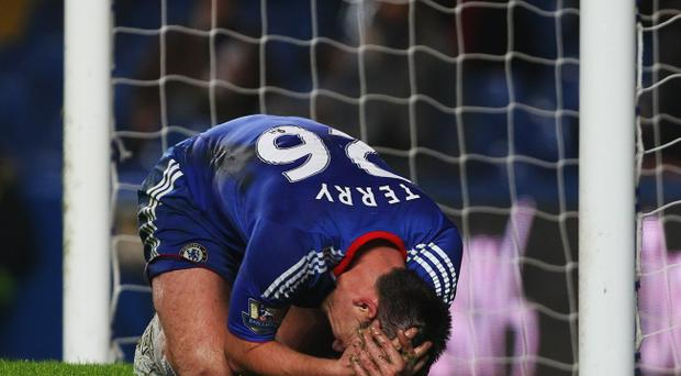 John Terry of Chelsea reacts during the Barclays Premier League match between Chelsea and Bolton Wanderers at Stamford Bridge on December 29, 2010 in London, England.