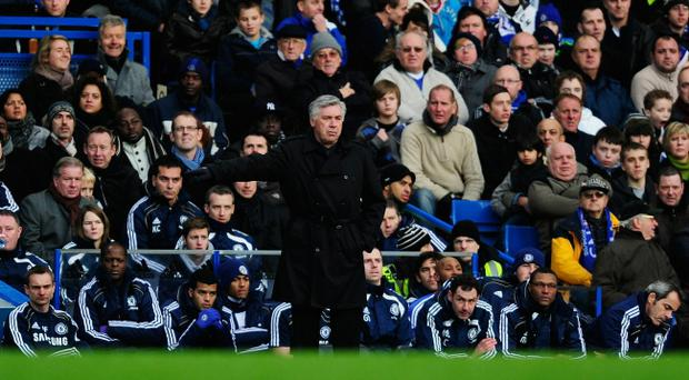 Carlo Ancelotti manager of Chelsea gestures from the bench during the Barclays Premier League match between Chelsea and Aston Villa at Stamford Bridge on January 2, 2011 in London, England.