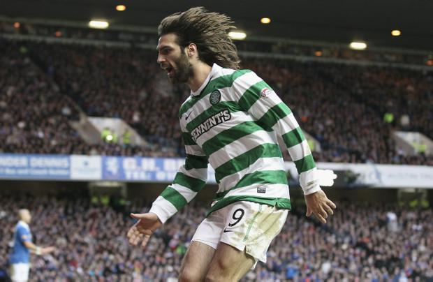 Georgios Samaras of Celtic celebrates after he scored the first goal during the Clydesdale Bank Premier League match between Rangers and Celtic at Ibrox Stadium on January 2, 2011 in Glasgow, Scotland.