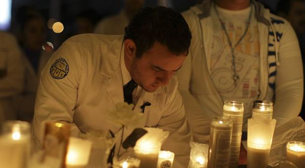 Doctors and nurses hold a candlelight protest against violence in Ciudad Juarez, Mexico (AP)