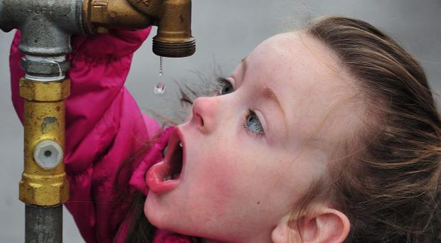Cliodhna Maguire aged 6 from Belfast , takes a drink of water from a water tap at Olympia