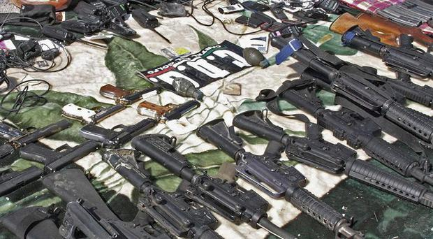 Guns and paraphernalia are shown by the Mexican Navy after a shootout between unidentified gunmen and Mexican marines (AP)