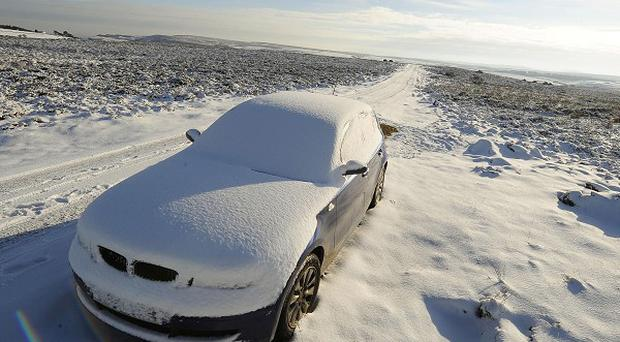 Parts of the country suffered fresh snow showers as Britons returned to work