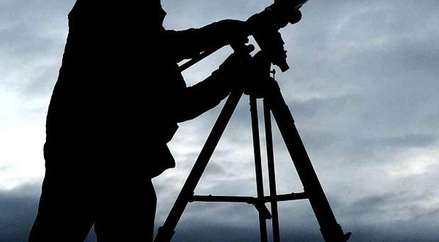 A member of the Newcastle Astronomical Society tries to view the solar eclipse at Whitley Bay