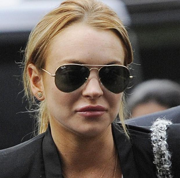 Lindsay Lohan faces being charged with assault over last month's clash with a rehab centre worker (AP)