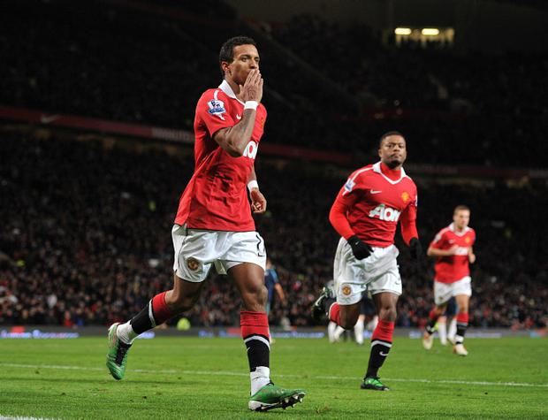 Manchester United's Nani (left) celebrates scoring his side's second goal during the Barclays Premier League match at Old Trafford, Manchester.