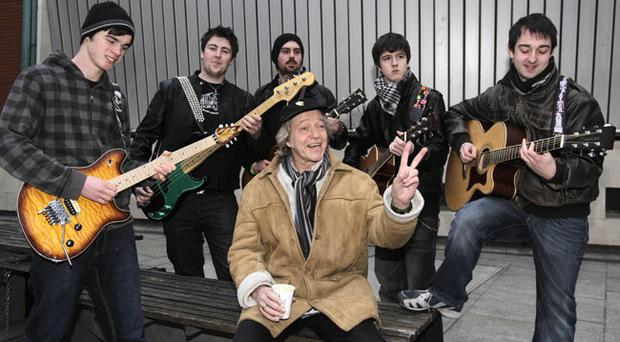 Eric Bell, founder member of Thin Lizzy, joins young guitarists (left to right) Shane O'Raw, Paddy Lennon, Niall Henney, Matthew Brady and Neil McNamara at the beginning of a flash mob in Temple Bar, Dublin