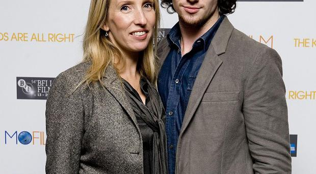 Aaron Johnson and Sam Taylor-Wood after Johnson topped the GQ Best-Dressed List of 2011