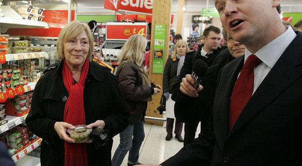 Lib Dem leader Nick Clegg talks to shoppers during a visit to an Asda supermarket in Shaw