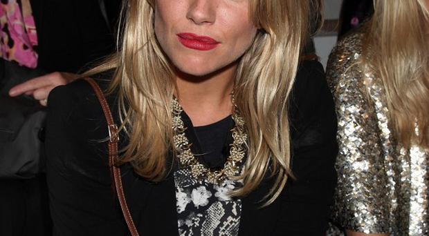 A journalist has been suspended over phone hacking claims involving the actress Sienna Miller