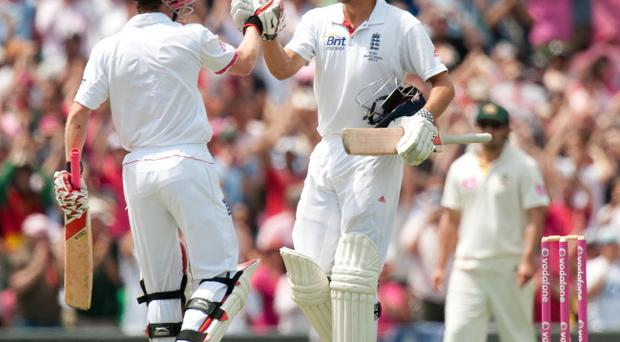 England's Alastair Cook celebrates with Paul Collingwood after reaching his century during the fifth Ashes Test at the Sydney Cricket Ground, Sydney, Australia.