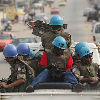 UN troops from Niger patrol the streets of Abidjan, Ivory Coast (AP)
