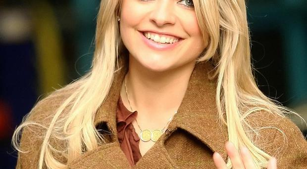 Holly Willoughby has revealed she is expecting a baby girl