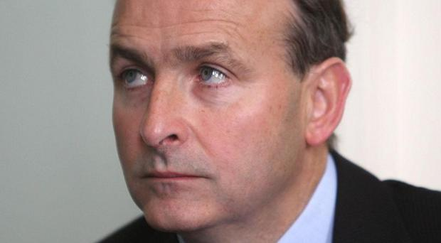 Foreign Affairs Minister Micheal Martin has praised the number of people across the world taking up Irish citizenship