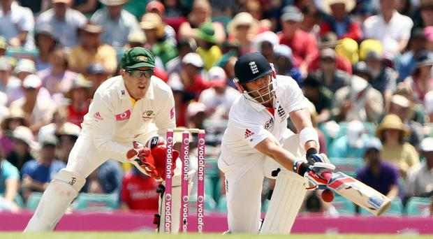 Matt Prior plays a sweep shot as wicket-keeper Brad Haddin looks on during day four of the Fifth Ashes Test