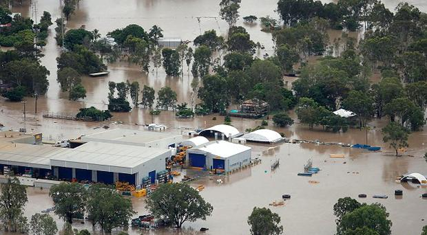 A rural industrial area, south of Rockhampton, Australia, is overwhelmed by floodwaters (AP)
