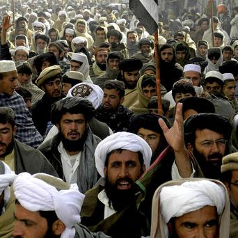 Supporters of Pakistani religious party Jammiat Ulema-e-Islam rally to condemn US drone attacks (AP)