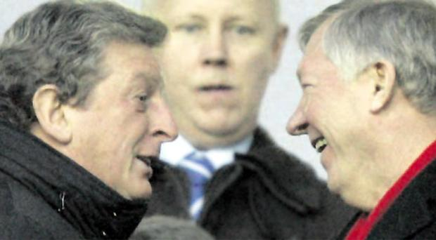Old pals: Roy Hodgson and Sir Alex Ferguson share a joke but the laughing will stop when Liverpool travel to Manchester United