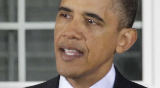 US President Barack Obama has forcefully declared his support for US civilian trials of Guantanamo detainees (AP)