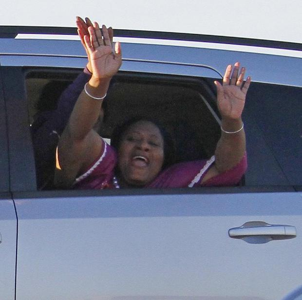 Jamie Scott waves from a vehicle as she and her sister Gladys Scott (behind) leave the Central Mississippi Correctional Facility (AP)