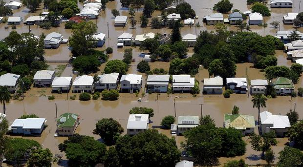 Floodwaters are seen in the Depot Hill district of Rockhampton, Australia (AP)