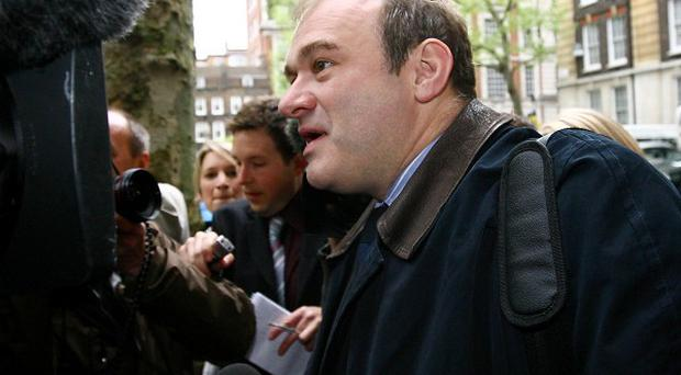 Postal minister Ed Davey says the Queen's head will remain on stamps