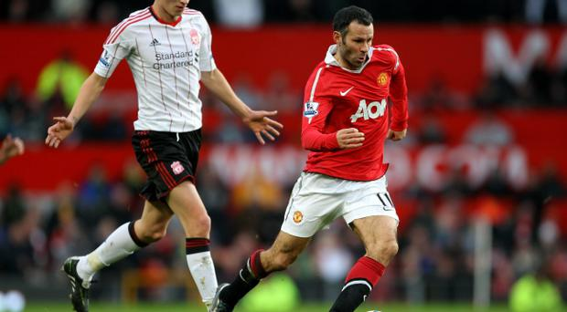 Ryan Giggs of Manchester United goes past Jonjo Shelvey of Liverpool during the FA Cup sponsored by E.ON 3rd round match between Manchester United and Liverpool at Old Trafford on January 9, 2011 in Manchester, England.