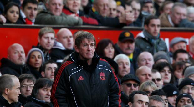 Liverpool Manager Kenny Dalglish looks on during the FA Cup sponsored by E.ON 3rd round match between Manchester United and Liverpool at Old Trafford on January 9, 2011 in Manchester, England.