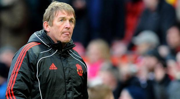 Liverpool manager Kenny Dalglish walks off the pitch dejected after the final whistle during the FA Cup Third round match at Old Trafford, Manchester.