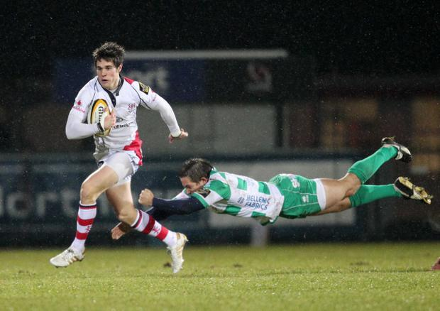 Adam D'Arcy resists a tackle from Treviso's Andrew Vilk but Ulster produced a second-rate display after the break
