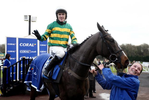 Tony McCoy celebrates completing the full set after victory in the Welsh National at Chepstow on board Synchronised.