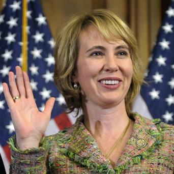 US Congresswoman Gabrielle Giffords is said to be 'responding' to basic commands after she was shot in the head in Arizona (AP)